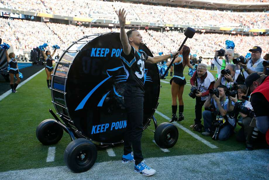 "SANTA CLARA, CA - FEBRUARY 07:  Stephen Curry of the Golden State Warriors prepares to hit the ""Keep Pounding"" drum for the Carolina Panthers prior to Super Bowl 50 against the Denver Broncos at Levi's Stadium on February 7, 2016 in Santa Clara, California.  (Photo by Kevin C. Cox/Getty Images) Photo: Kevin C. Cox, Getty Images"