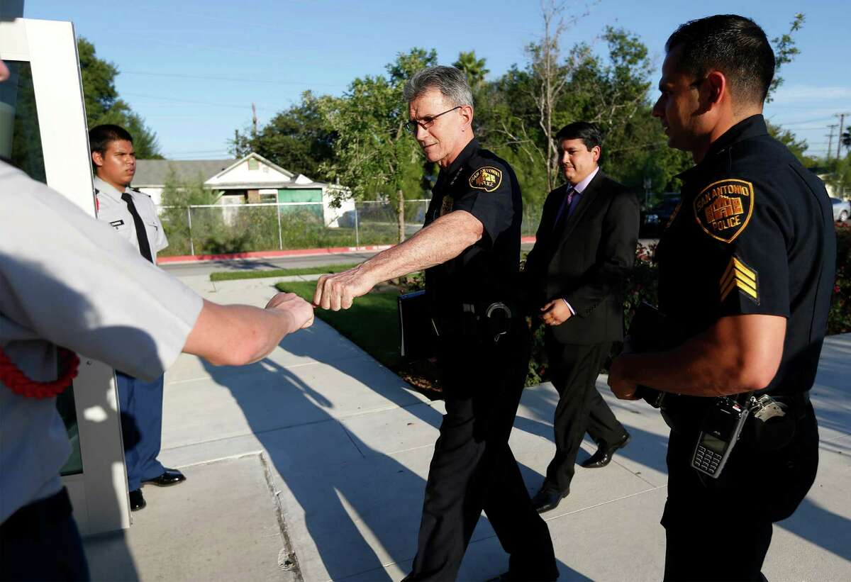 Police Chief William McManus (center) greets Christopher Kimerer, a sophomore ROTC student at Sam Houston High on Wednesday, Sept. 21, 2016. On Wednesday night, the city is holding the first meeting of the Mayor?'s Council on Police-Community Relations (CPCR), at the Career & Technical Education building at Sam Houston High School, 4635 E. Houston St., 78220. The council includes almost three dozen community leaders, including a former county commissioner, religious leaders, a candidate for the Texas House of Representatives, police union members and a representative for a current state rep. will be in attendance. (Kin Man Hui/San Antonio Express-News)