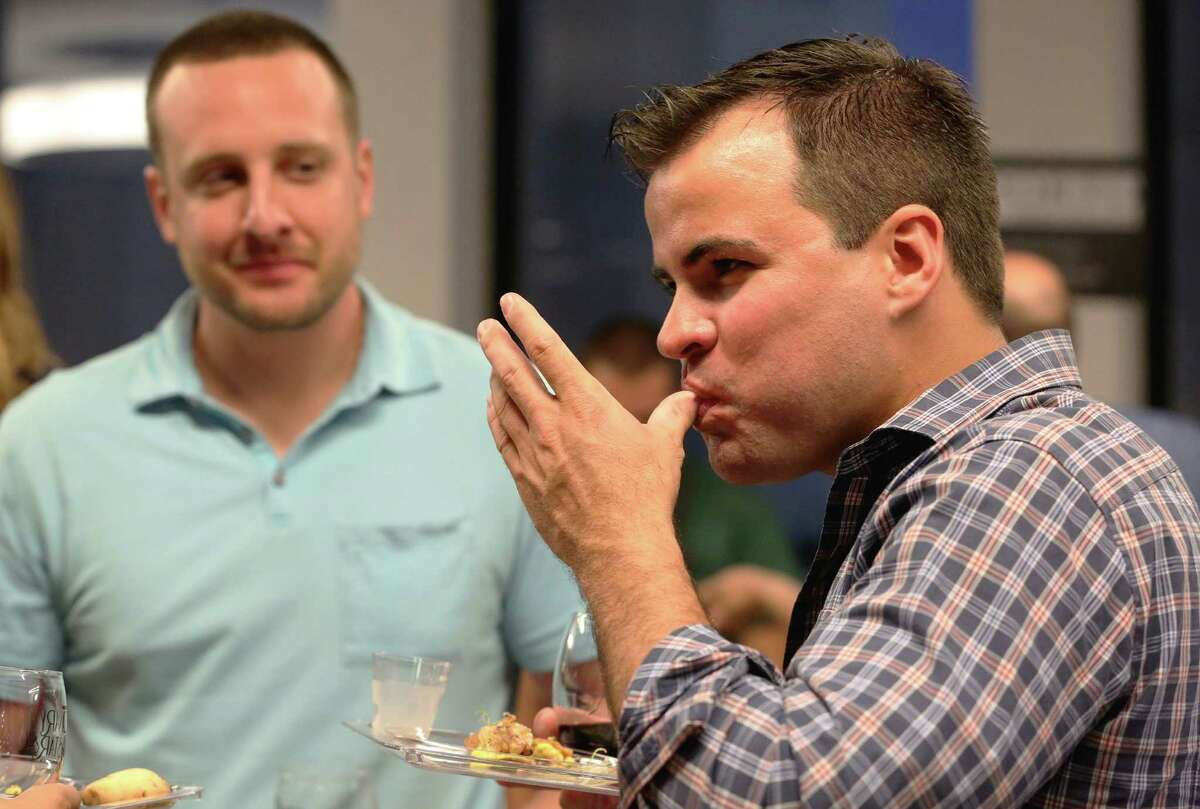 David Lanier has a bite of food at the Culinary Stars party.