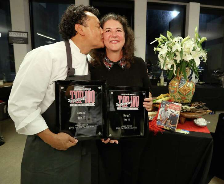 Hugo Ortega and Tracy Vaught pose for a photo to celebrate Hugo's and Caracol's win at the annual Houston Culinary Stars at Houston Chronicle Wednesday, Sept. 21, 2016, in Houston. Hugo's was named No.2 and Caracol was named No.8 of Alison Cook's Top 100 restaurants list.