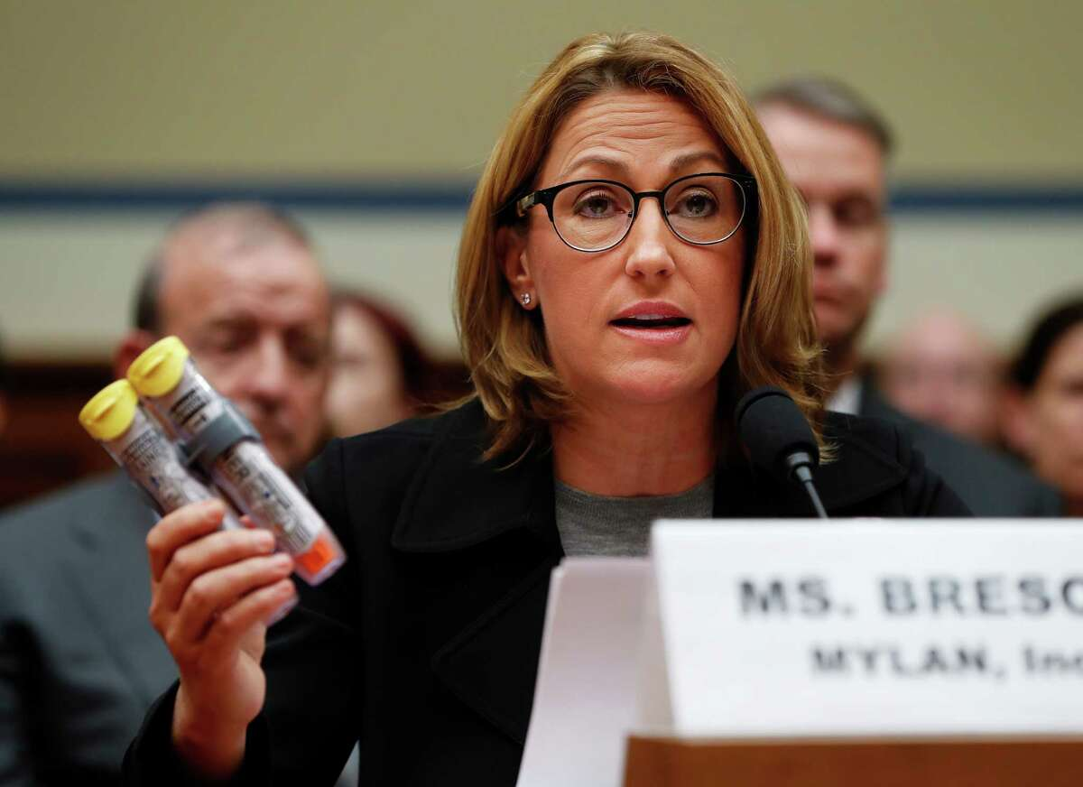 Mylan CEO Heather Bresch holds up an EpiPen while testifying on Capitol Hill in Washington, Wednesday, Sept. 21, 2016, before the House Oversight Committee hearing on EpiPen price increases. Bresch defended the cost for life-saving EpiPens, signaling the company has no plans to lower prices despite a public outcry and questions from skeptical lawmakers. (AP Photo/Pablo Martinez Monsivais) ORG XMIT: DCPM129