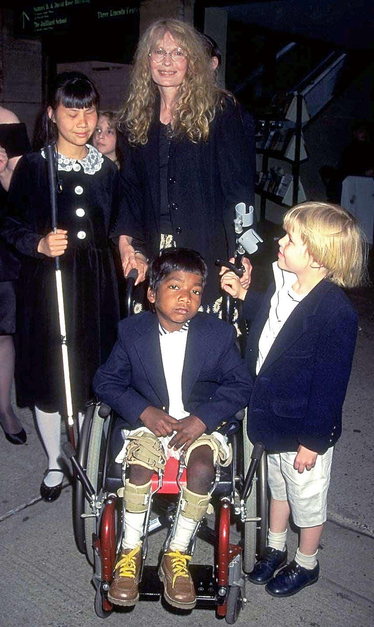 Actress Mia Farrow and her children, including Thaddeus, center.