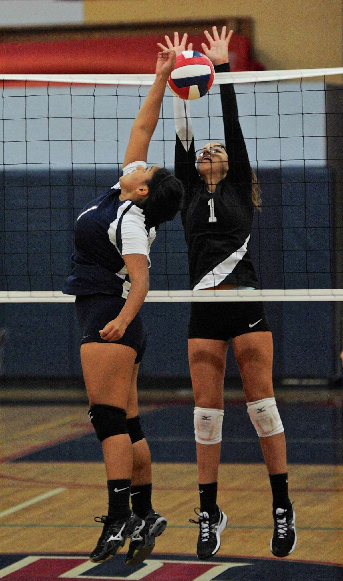 Bethel's Clarisa Rosario (1) blocks the ball hit by New Fairfield's Mia Maisonave (1) in the SWC girls volleyball game between Bethel and New Fairfield high schools. Wednesday, September 21, 2016, at New Fairfield High School, New Fairfield, Conn.