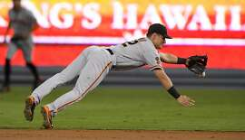 San Francisco Giants second baseman Joe Panik can't reach a ball hit for a single by Los Angeles Dodgers' Howie Kendrick during the first inning of a baseball game, Wednesday, Sept. 21, 2016, in Los Angeles. (AP Photo/Mark J. Terrill)