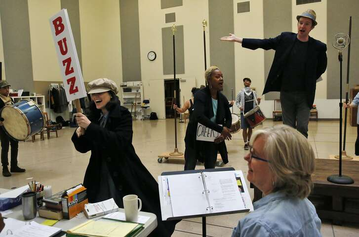 Director Lisa Peterson watches as actors, from left, Gabriel Montoya, Carolina Sanchez, Deidrie Henry, and Will Rogers perform during rehearsal of It Can't Happen Here at Berkeley Repertory Theatre Sept. 1, 2016 in Berkeley, Calif.