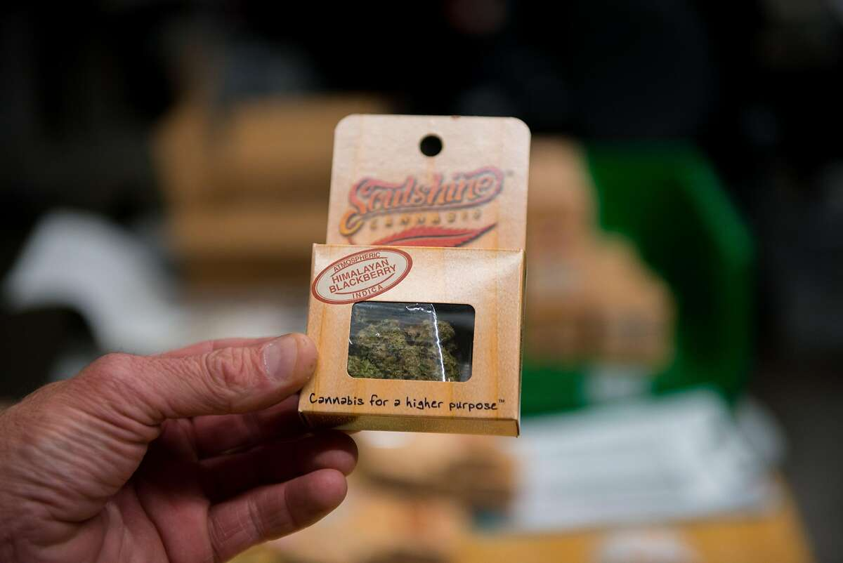 General Manager Rob Raymond holds up a fully packaged eighth of an ounce of Himalayan Blackberry cannabis, which will sell in stores for about $50 with tax. Soulshine Cannabis donates a portion of every sale to the Emerald City Pet Rescue. Sept. 20, 2016 at Soulshine Cannabis, a 50k-square-foot Tier III cannabis production and processing facility in an industrial area in Renton, Wash.