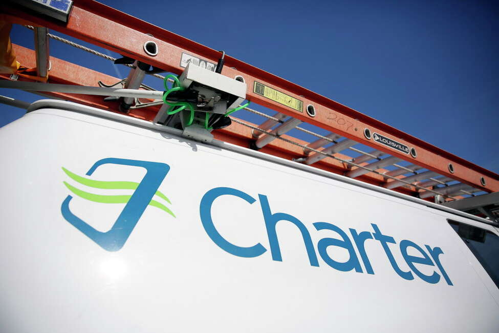 Charter Communications, the parent company of Spectrum cable TV, is creating a new community loan fund that will seek to make $10 million in loans to local community development lenders throughout the country where it has operations. (AP Photo/Jeff Roberson, File) ORG XMIT: NYBZ313