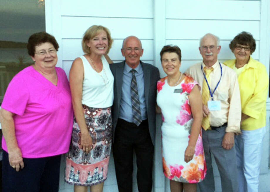 Photo provided From left are Mid Michigan Community College Board Vice Chair Betty Mussell, Trustee Terry Petrongelli, Professor Chuck Bowden, MMCC President Dr. Christine Hammond, Trustee Doug Jacobson and Trustee Carolyn Bay.