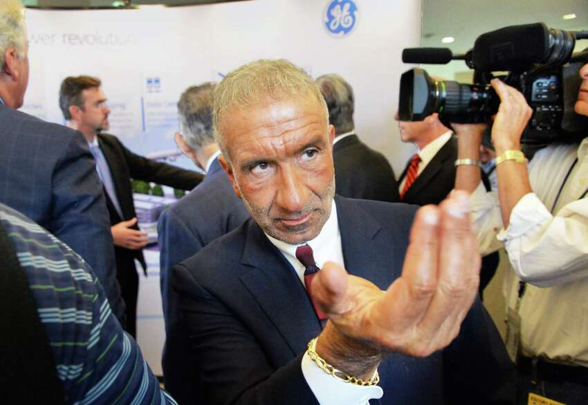 Albany Nanocollege CEO Alain Kaloyeros calls to an associate during the announcement of a new $500 million power electronics manufacturing consortium in the Capital Region at GE Global Research Tuesday July 15, 2014, in Niskayuna, NY. (John Carl D'Annibale / Times Union)