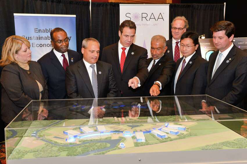 Gov. Cuomo, center, stands with Alain E. Kaloyeros, right, as he announces that part of his Buffalo Billion initiative New York State will build a state-of -the -anchor hub facility for high tech and green energy businesses at Riverbend in the city of Buffalo on Nov. 21, 2013, in Buffalo, N.Y. (Office of the Governor)