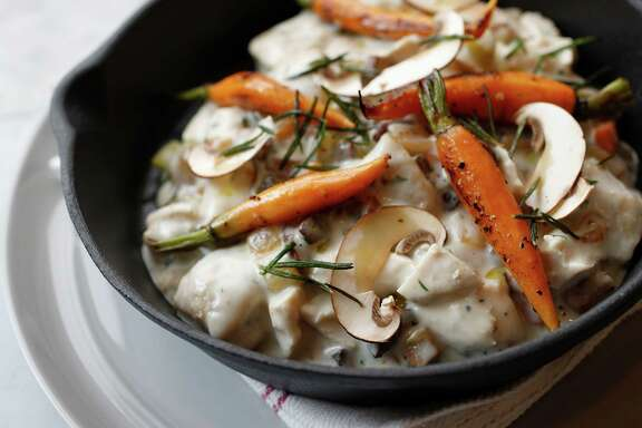 Chicken and Dumplings; Chicken confit with wheat and ricotta dumplings and wild mushrooms at the new Eloise Nichols Grill & Liquors restaurant, 2400 Mid Lane, Wednesday, Sept. 21, 2016 in Houston.  Siblings Nicholas Adair and Katie Adair Barnhart, who are responsible for Adair Kitchen in the Galleria neighborhood. This new restaurant, named for their paternal grandmother, is meant to be a hip neighborhood restaurant.