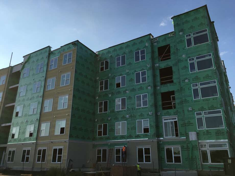An apartment project on South Braeswood just inside Loop 610, is one of many complexes under construction in the Houston area. Photo: Katherine Feser, Houston Chronicle