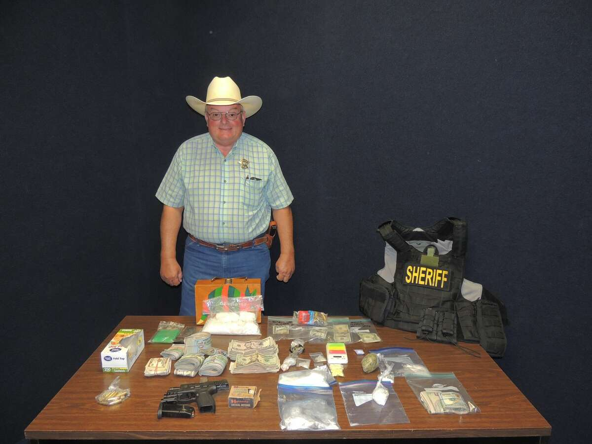 Guadalupe County Sheriff Arnold S. Zwicke poses with all the drugs that were confiscated from the drug bust on Sept. 20, 2016, in New Braunfels.