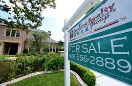 (FILES) This file photo taken on May 17, 2016 shows a house for sale in Arcadia, California. US sales of existing homes slowed for the second straight month in August, with tight supply partly to blame, the  National Association of Realtors said September 21, 2016 . Despite mortgage loan rates running at record lows and new hiring by companies strong, used home sales across the United States fell 0.9 percent in the month, after a 3.2 percent drop in July.  / AFP PHOTO / FREDERIC J. BROWNFREDERIC J. BROWN/AFP/Getty Images