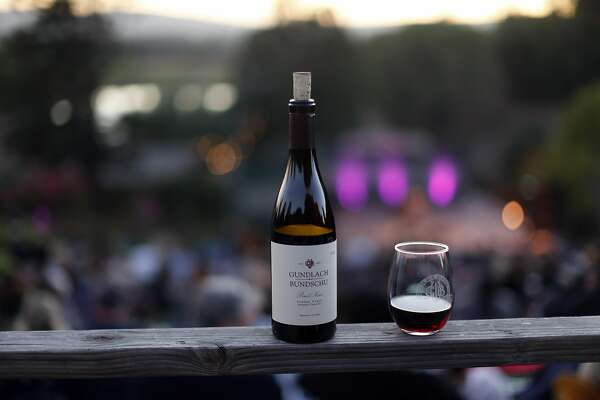 A bottle of Pinot Noir sits on a railing before Iron & Wine concert at Gunlach Bundschu Winery in Sonoma, Calif., on Wednesday, September 21, 2016.