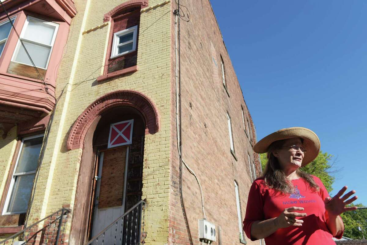 Peggy Kownack talks about being a child and living at 36 Douw Street, background, during an interview on Tuesday, Sept. 13, 2016, in Troy, N.Y. (Paul Buckowski / Times Union)