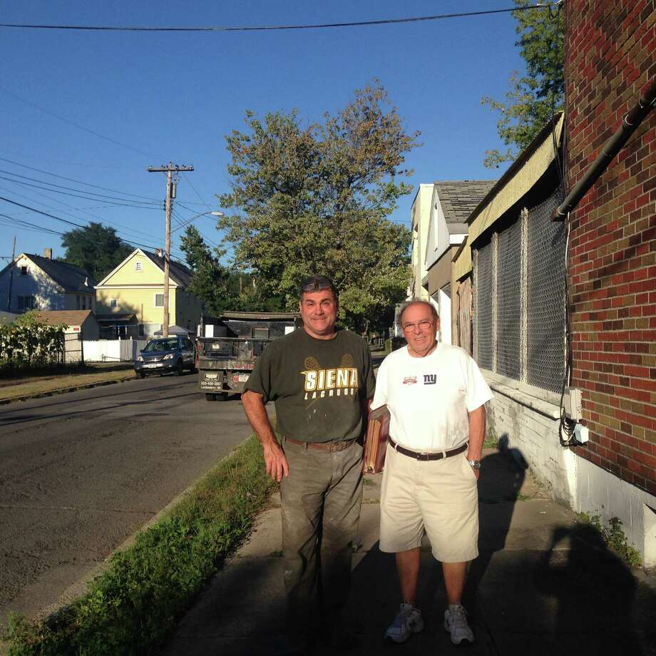 Mario, left, and Carmen Pantalone outside 1402 6th Ave., Schenectady (photo by Amy Biancolli)