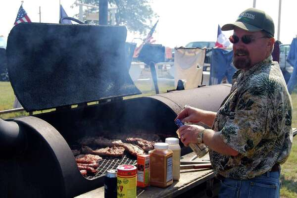 With meat on the grill and a variety of special seasonings at the ready, this Karnes County Lonesome Dove Fest cook-off contestant braves the September heat to prepare entries for judges at the 20154 cook-off competition on the grounds of the Karnes County Youth Show Barn.