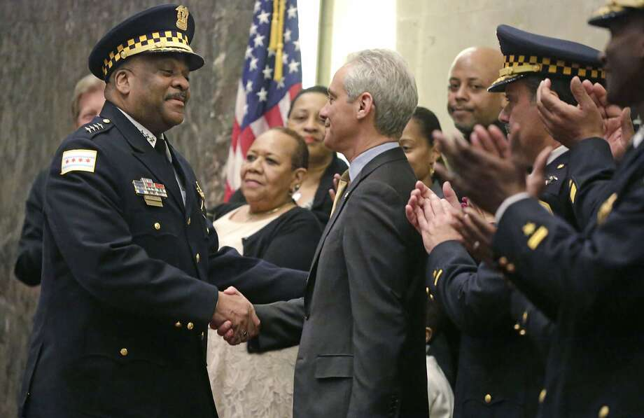 Chicago Mayor Rahm Emanuel shakes hands with Eddie Johnson after swearing him in as the new Chicago police superintendent in April. Photo: M. Spencer Green, Associated Press