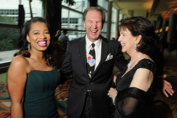 From left: Shawntell McWilliams shares a laugh with John and Shirlee Jamail at the Health Museum's  Hearts of Gold Gala at the Hilton Americas Hotel Friday Sept. 16, 2016. (Dave Rossman Photo)