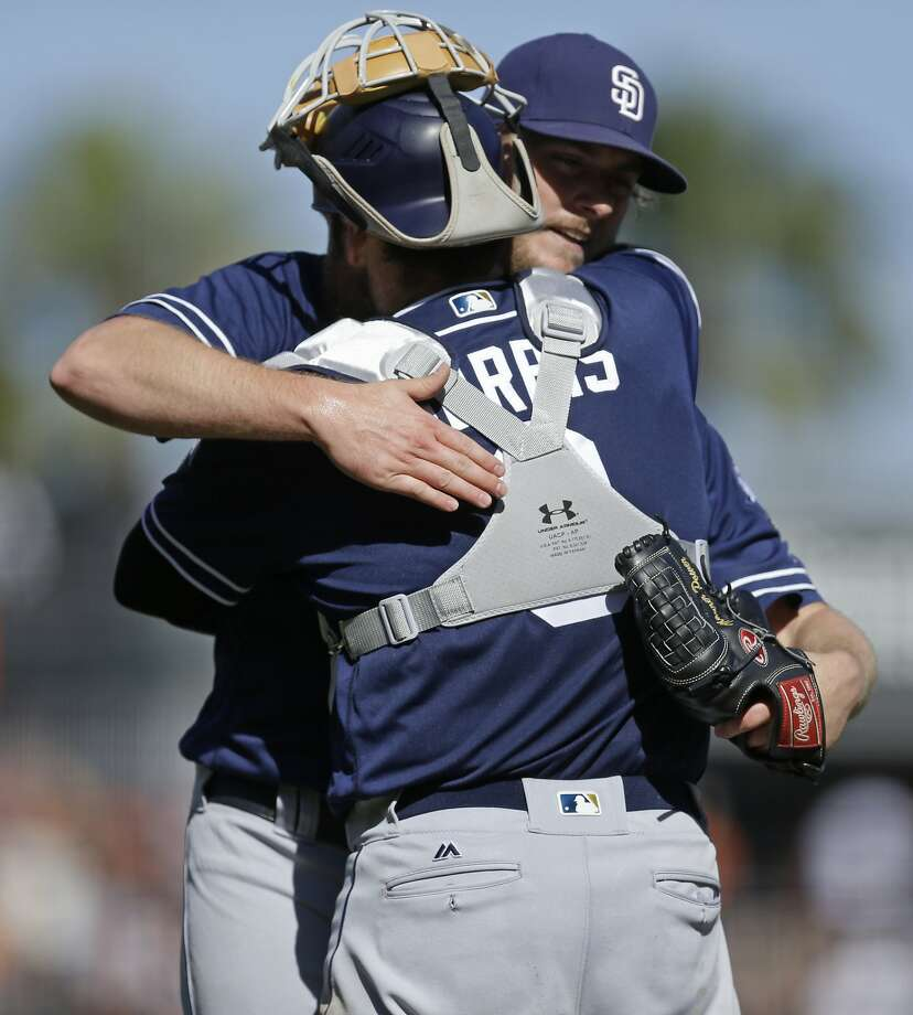 Catcher Derek Norris hugs closer Brandon Maurer after the Padres closed out a 3-1 victory against the Giants at AT&T Park last week. San Diego pitchers have gotten a lot of Derek Hugs after Giants games lately. Photo: Ben Margot, Associated Press
