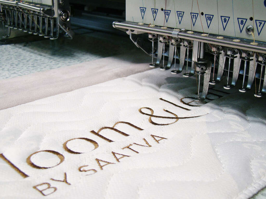 a mattress is inscribed with the saatva name at the factory - Saatva Mattress
