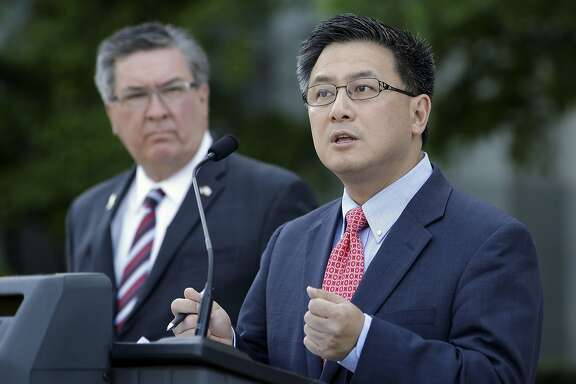 State Treasurer John Chiang, right, calls for passage of a bill by Assemblyman Ken Cooley, D-Rancho Cordova, left, to require all public pension funds to publicly disclose the fees paid to alternative investment vehicles, at a news conference Tuesday, May 31, 2016, in Sacramento, Calif. The Assembly approved AB2833, Tuesday, and sent it to the Senate. (AP Photo/Rich Pedroncelli)
