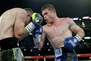 Canelo Alvarez (right) punches Liam Smith fight during the WBO junior middleweight championship boxing match at AT&T Stadium in Arlington on Sept. 17, 2016. Alvarez won by a knock out in the ninth round.