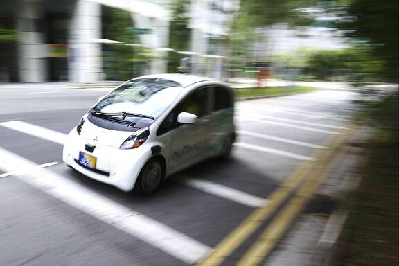 An autonomous vehicle is driven during its test drive in Singapore Wednesday, Aug. 24, 2016. The world�s first self-driving taxis, operated by nuTonomy, an autonomous vehicle software startup, will be picking up passengers in Singapore starting Thursday, Aug. 25. The service will start small - six cars now, growing to a dozen by the end of the year. The ultimate goal, say nuTonomy officials, is to have a fully self-driving taxi fleet in Singapore by 2018, which will help sharply cut the number of cars on Singapore�s congested roads. (AP Photo/Yong Teck Lim)