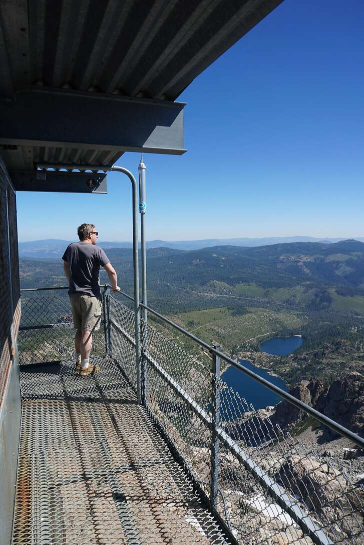 tanding on top of the world at the Sierra Buttes lookout.