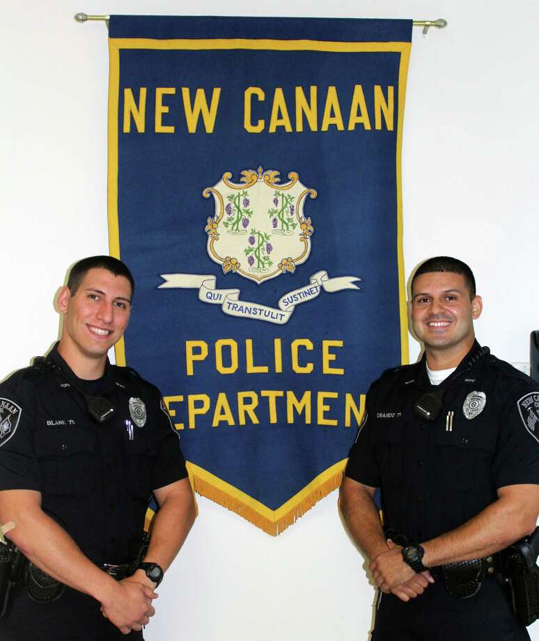 Matthew Blank, left, and Sebastian Obando graduated from the police academy on Sept. 15 and are training with the New Canaan Police Department. Photo: Erin Kayata / Hearst Connecticut Media / New Canaan News