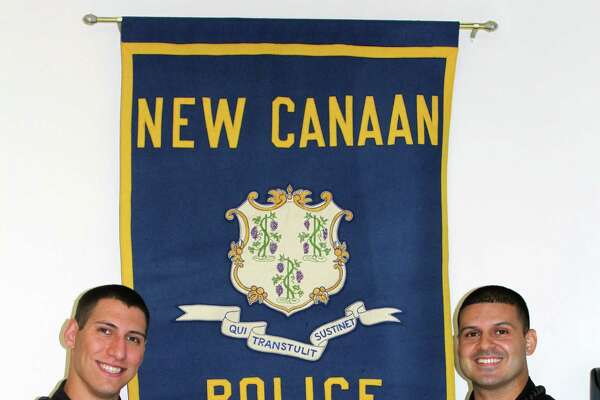 Matthew Blank, left, and Sebastian Obando graduated from the police academy on Sept. 15 and are training with the New Canaan Police Department.
