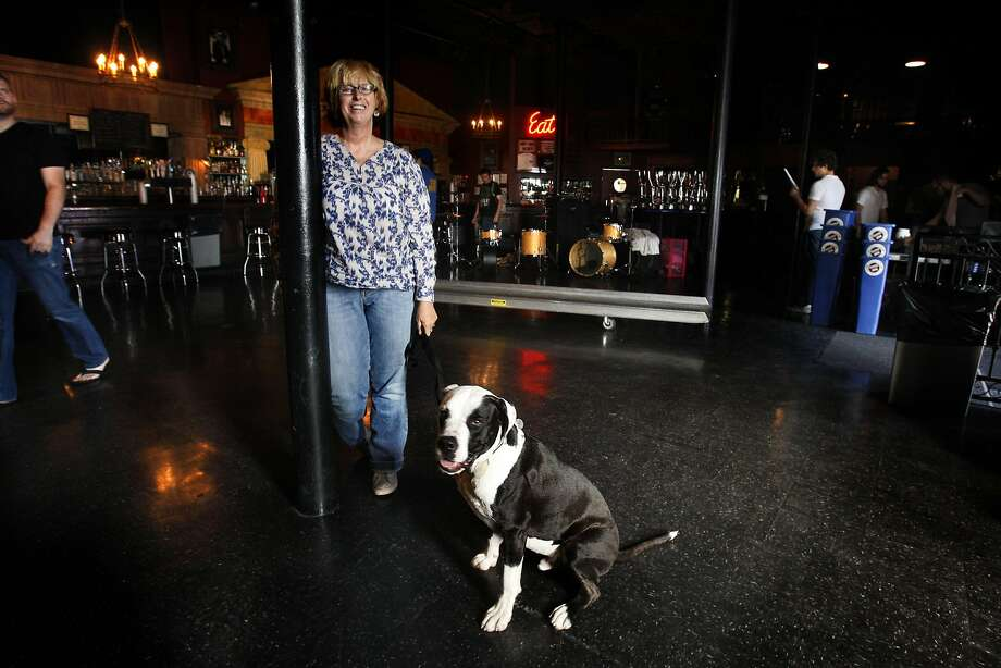 Dawn Holliday, booking agent for Slim's and the Hardly Strictly Bluegrass Festival coming up in October, with her puppy Joey at the club in San Francisco, Calif., on Friday, August 7, 2009. Photo: Liz Hafalia, The Chronicle