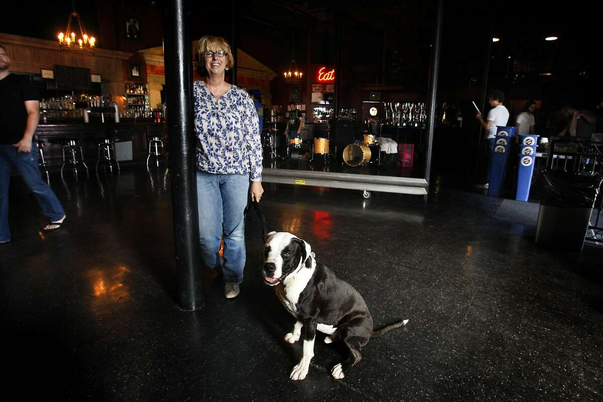 Dawn Holliday, booking agent for Slim's and the Hardly Strictly Bluegrass Festival coming up in October, with her puppy Joey at the club in San Francisco, Calif., on Friday, August 7, 2009.
