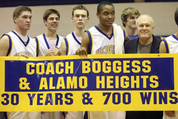 Alamo Heights players surround coach Charlie Boggess after his 700 win against Fox Tech at Alamo Heights gym on Dec.11, 2007.