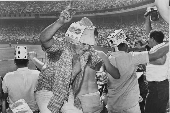 These fans in the bleachers go wild as Willie mays hits a homer during  Game 1 of of the playoffs betwen the Giants and the Dodgers at  Candlestick Park.