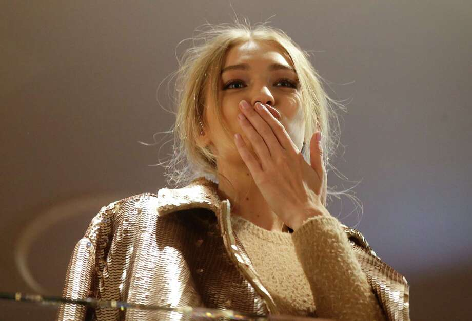 Model Gigi Hadid, hosted by Max Mara, blows kisses to fans from the flagship store during the women's Spring-Summer 2017 fashion event, in Milan, Italy, Wednesday, Sept. 21, 2016. . Photo: Luca Bruno, AP / Copyright 2016 The Associated Press. All rights reserved.