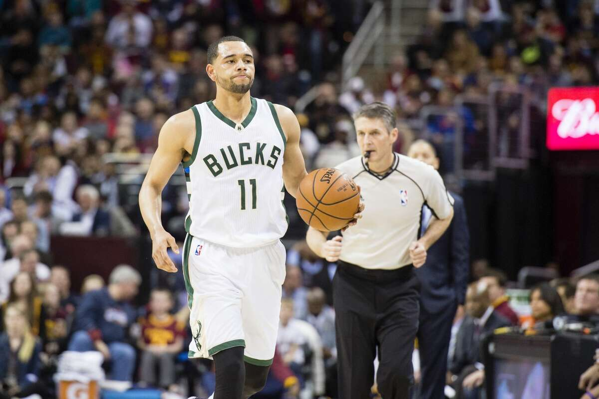 CLEVELAND, OH - MARCH 23: Tyler Ennis #11 of the Milwaukee Bucks drives down the court during the first half against the Cleveland Cavaliers at Quicken Loans Arena on March 23, 2016 in Cleveland, Ohio. NOTE TO USER: User expressly acknowledges and agrees that, by downloading and/or using this photograph, user is consenting to the terms and conditions of the Getty Images License Agreement. Mandatory copyright notice. (Photo by Jason Miller/Getty Images)