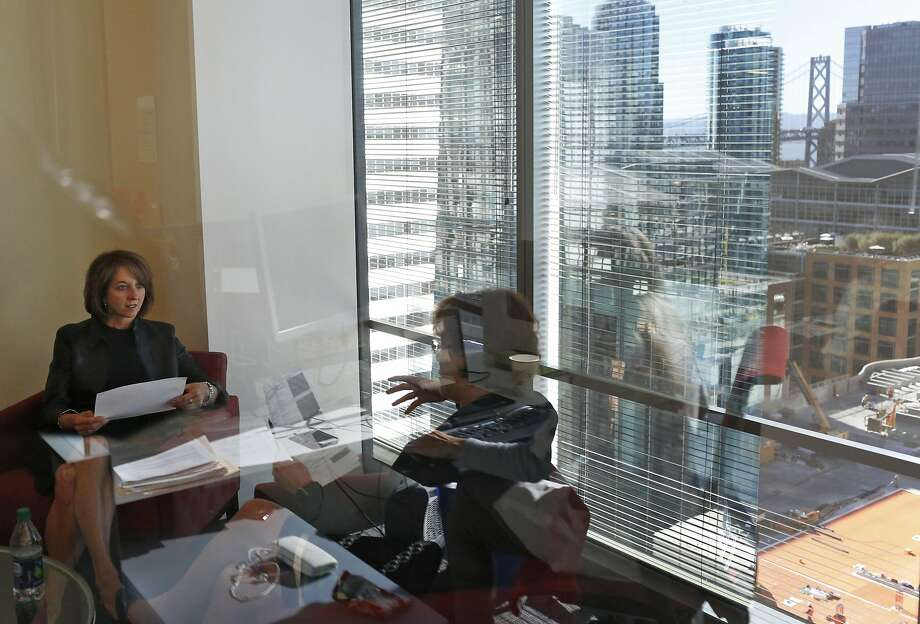 Teresa Briggs (left) meets with tax partner Kay Pitman at Deloitte's San Francisco office. Briggs pushed for a better policy for caregivers. Photo: Leah Millis, The Chronicle