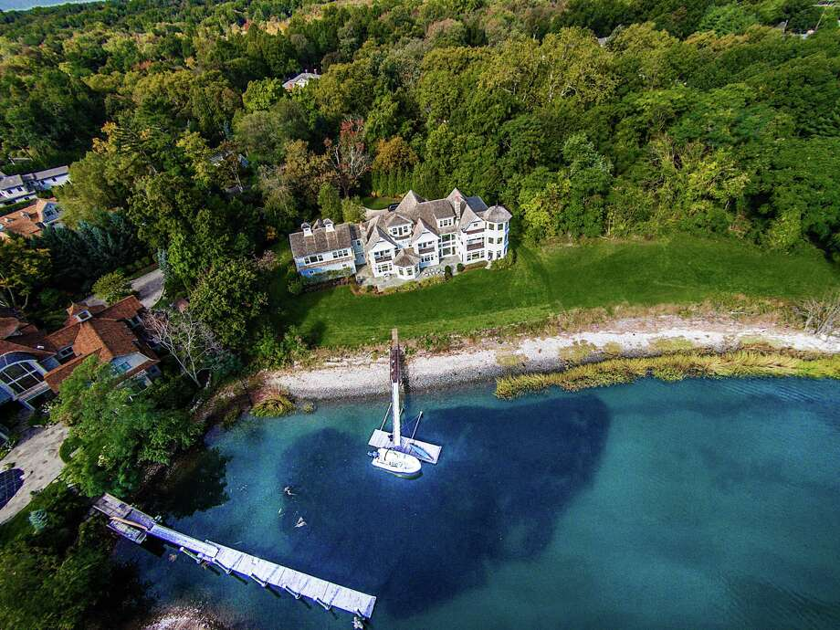 An aerial view of the house at 3 Charmers Landing in the Saugatuck Shore section of Westport. It sits on a tranquil cove along the Saugatuck River near the mouth of Long Island Sound. Photo: Contributed Photos / Westport News