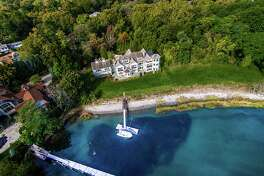 An aerial view of the house at 3 Charmers Landing in the Saugatuck Shore section of Westport. It sits on a tranquil cove along the Saugatuck River near the mouth of Long Island Sound.