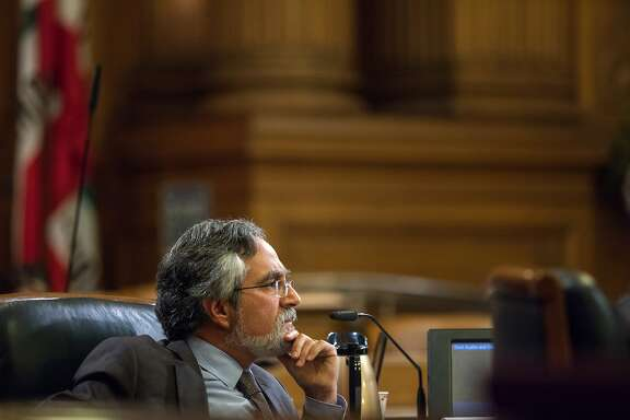 Aaron Peskin of the Board of Supervisors listens to Department of Building Inspection officials during a meeting on Thursday, Sept. 22, 2016 in San Francisco, Calif. The Millennium Tower, located at 301 Mission Street, is sinking. Supervisors met with the Department of Building Inspection, among other officials for a hearing on the building, a 58-story condo tower which has sunk 16 inches since it opened in 2009.