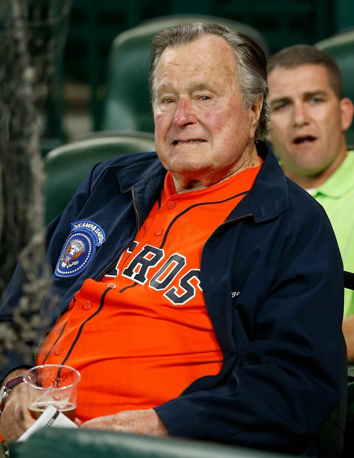 Former President George H.W. Bush throws out the first pitch to Collin McHugh #31 at Minute Maid Park on April 12, 2016 in Houston, Texas.