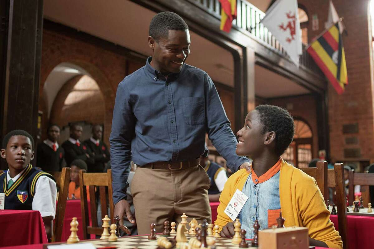 In this image released by Disney, Madina Nalwanga, right, and David Oyelowo appear in a scene from