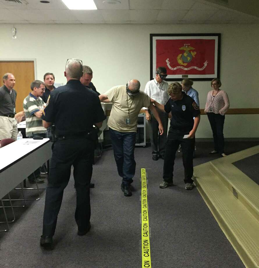 During a drunk goggle simulation, David Vita attempts to walk in a straight line while wearing goggles that mimic a .08 to .15 blood alcohol content. The simulation was part of a DUI presentation during the second Westport Citizens' Police Academy class on Sept. 15, 2016 in Westport, Conn. Photo: Laura Weiss / Hearst Connecticut Media / Westport News