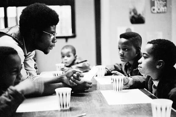 Panther Jerry �Odinka� Dunigan talks to kids while they eat breakfast on Chicago�s South Side, November 1970