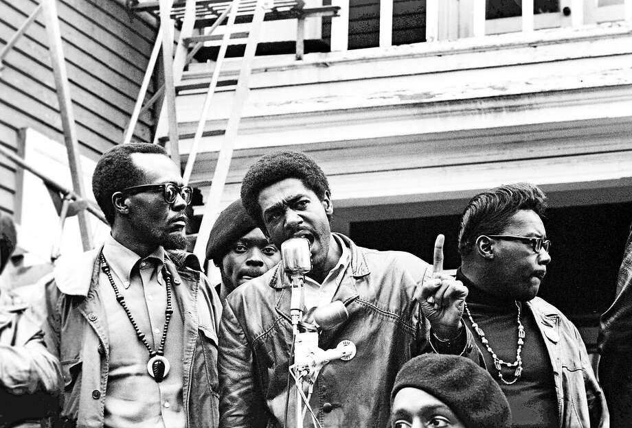 "Bobby Seale speaks at a Free Huey rally in DeFremery Park in Oakland in 1968. With Seale is Bill Brent (left), who later went to Cuba, and Wilford Holiday, known as ""Captain Crutch."" Photo: Stephen Shames, Courtesy Of Steven Kasher Gallery, Polaris"