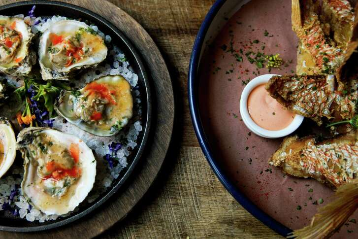 Wood-broiled oysters and Snapper throats at Southerleigh Fine Food & Brewery at the Pearl Brewery.