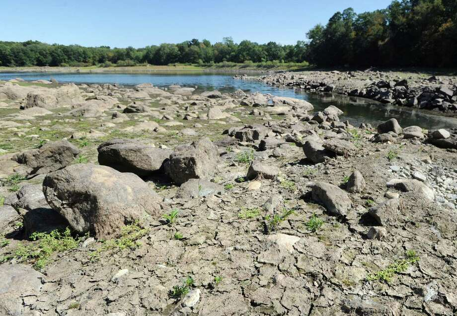The depleted water reservoir off of North Street in Greenwich. Photo: Bob Luckey Jr. / Hearst Connecticut Media / Greenwich Time