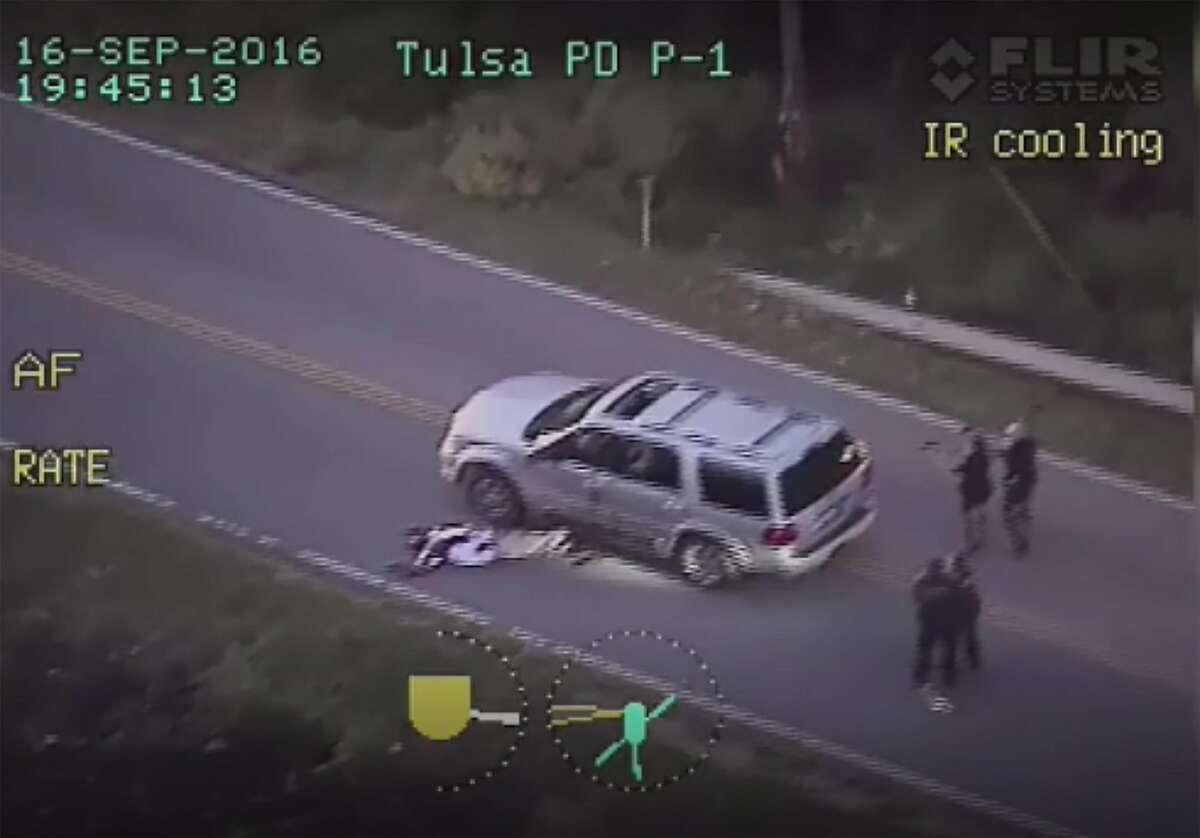 In this image from video provided September 20, 2016 by the Tulsa Police Department in Tulsa, Oklahoma shows the officer involved shooting of Terence Crutcher. US authorities have launched a civil rights probe into the police shooting of an unarmed black man in Tulsa, captured on video that sparked renewed outrage over law enforcement's treatment of African-Americans. The fatal shooting on September 16 of Terence Crutcher was recorded by police car dashboard cameras and a police helicopter camera in that city in Oklahoma. Tulsa Police Chief Chuck Jordan, in releasing the footage to the public on Monday, called it disturbing and